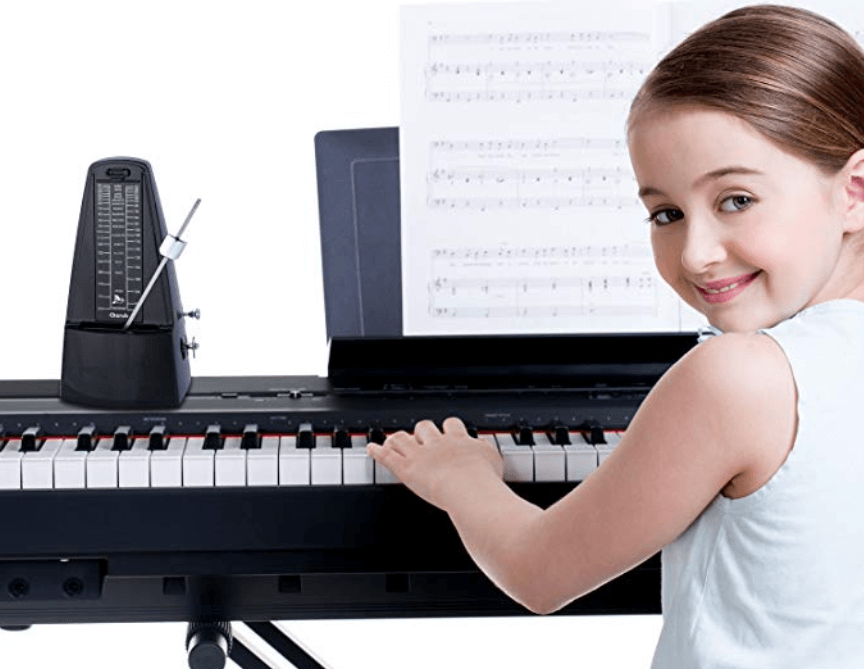 student practicing piano happily with the metronome