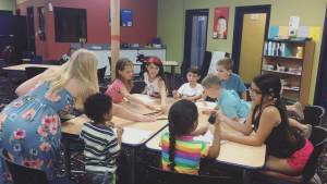 music summer camp teacher at craft time in Brandon
