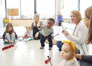 happy children and mothers at a toddler music class in Tampa