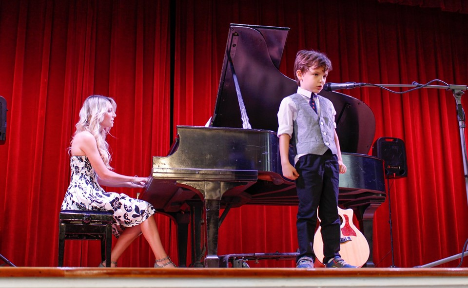 student performing after music lessons in Tampa for kids