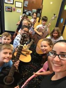 happy students at our music school in Tampa