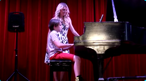 a student performing who takes piano lessons in Tampa