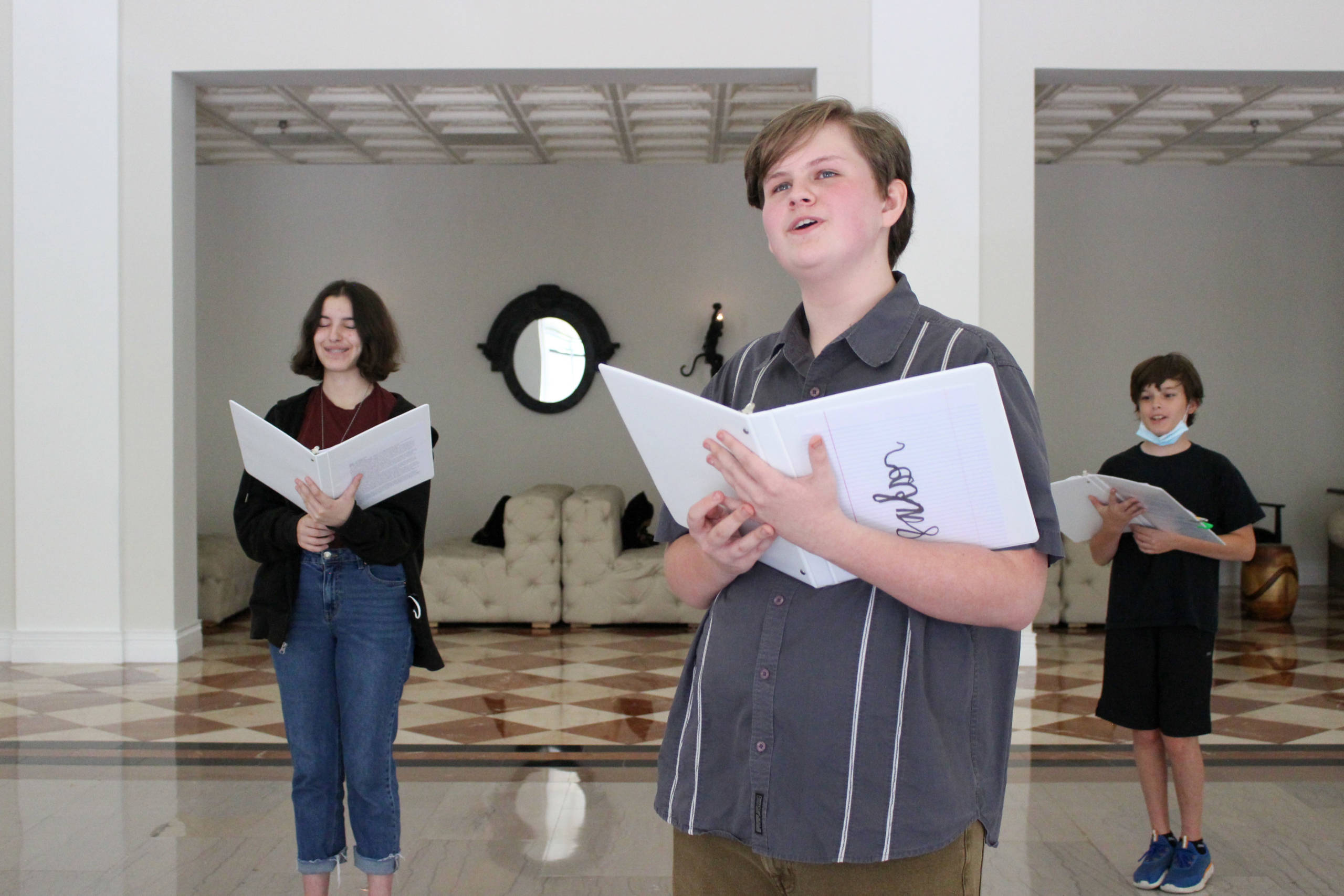 Three kids singing in their music lessons in Tampa
